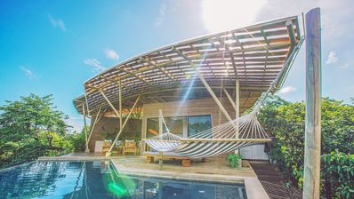 Photo for 10 mn to tamarindo perched house with superb views and swimming pool