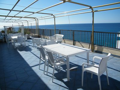 Photo for Penthouse with panoramic terrace overlooking the sea