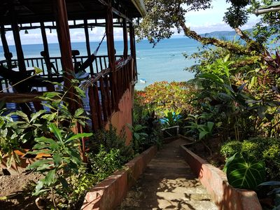 Photo for Incredible bungalow on top of the hill property with ocean view from garden