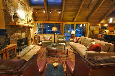 The Great Room that has the feel of the outdoors with large windows skylights in the vaulted timber ceiling and wood burning fireplace