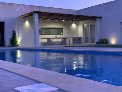 Photo for Modern and luxurious country house, olive grove and spectacular swimming pool overlooking the sea