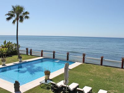 Photo for ELEGANT  PINK SEAFRONT VILLA, DIRECT ACCESS TO TEH BEACH , HEATED POOL