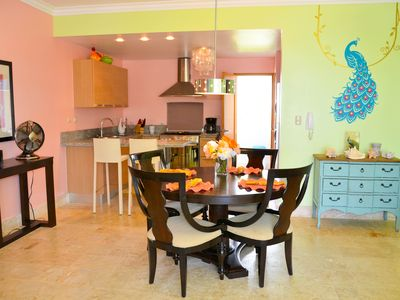 Photo for Beautiful well equipped condo steps from the beach, shopping and dining