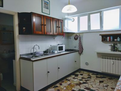 Photo for Independent apartment near the sea and comfortable five terraces with parking