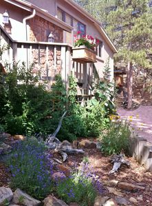 The hummingbirds love the flowers surrounding this Colorado-style house.