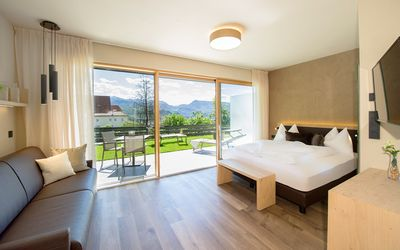 "Photo for Modern Apartment ""App. Weißburgunder"" with Mountain View, Wi-Fi, Garden, Pool, Sauna & Jacuzzi; Parking Available"