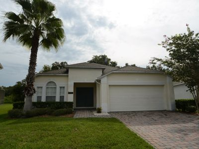 Photo for 4 Bedroom Gated Orlando Vacation Rental Pool Home with Lake View & Games Room!