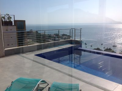 Photo for VILLA DESIGN IN ROSES ALMADRAVA BEACH WITH SEA VIEW AND OVERFLOW SWIMMING POOL