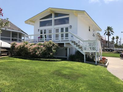 Photo for Mazatlan cottage in Key Allegro with Aransas Bay view front and canal view back