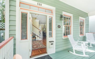 Step into your charming clapboard house.