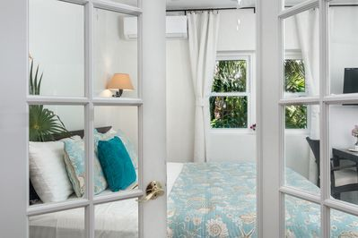 French doors leading into the bedroom