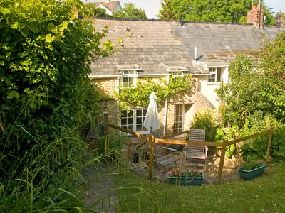 Photo for Traditional Dorset Stone Cottage, large garden, pretty village near sea.