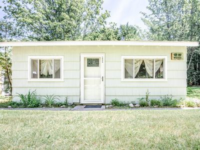 Photo for Stay steps away from Lake Charlevoix with this 2-bedroom, 1-bathroom cabin.