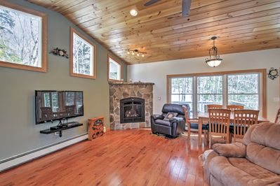 Cozy up by the fireplace of this vacation rental house during cool evenings.