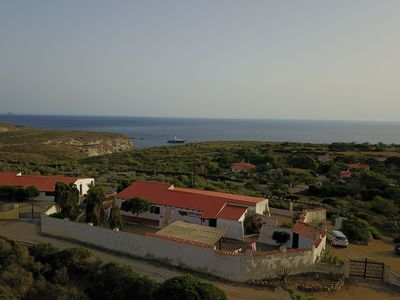 Villa air view with the mediterranean sea in the background