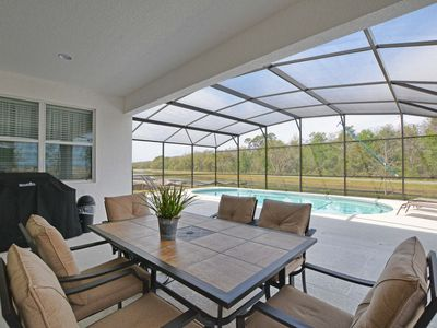 Photo for LARGE POOL*Lake View*Grill*BILLIARDS*PING PONG*Idyllic modern home*10 min Disney