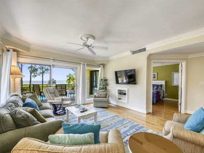Photo for Stylish 2 bedroom / 2 bath Beachside Tennis villa with Calibogue Sound views, community pool and acc