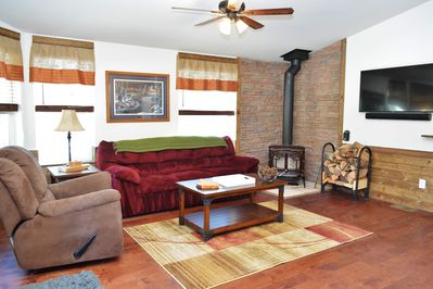Comfortable couch and a recliner make this room a great place to relax and forget about anything but your mountain getaway.
