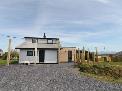 Photo for FOREST LODGE, pet friendly, with open fire in Newborough, Ref 974110