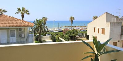 Photo for Nettuno, very new apartment with sea view, about 50 mt from the beach and the Pr