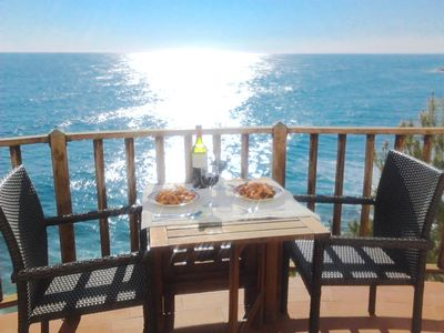 Photo for Sitges. Mediterranean Balcony. Amazing views. Beach and pool. A/C. Parking. WIFI