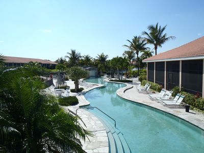 Photo for Heaven on Earth!  Large Lakefront Lanai, Beautiful Lazy River Pool!!