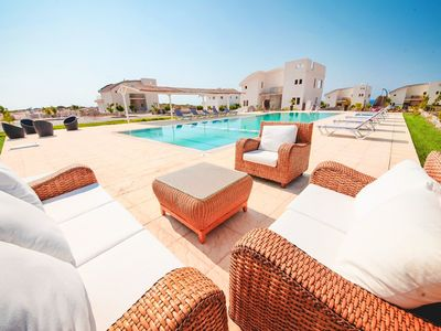 Photo for Homerez last minute deal - Big villa with shared pool and garden