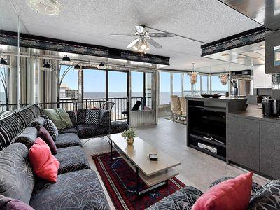 Photo for Fun 2 bedroom oceanfront penthouse condo with HBO channels, indoor pool, and WiFi access located uptown and steps to the beach!
