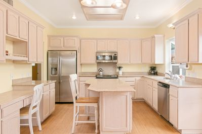 Kitchen - The kitchen with a center island, granite countertops and stainless steel appliances