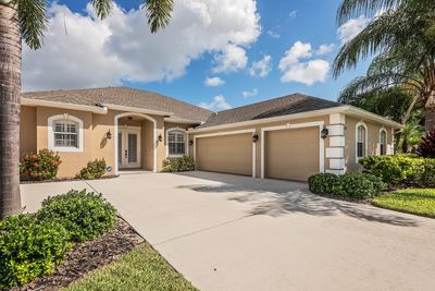 Front of home 2,142 sq. ft. under air featuring 4 bedrooms and 3 full bathrooms