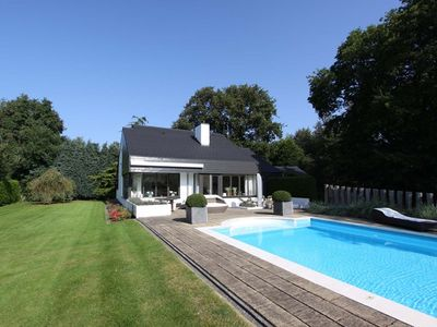 Photo for Jan van Renesseweg 28 villa with heated pool in prime location
