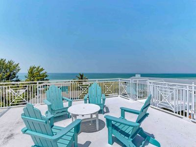 Photo for Luxury Gulf view home w/ heated pool, and roof deck - steps to the beach!