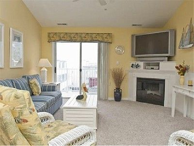 Relax in this professionally decorated living room; sofa is a queen size sleeper