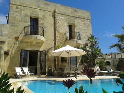 Kitchen and living room overlooking pool area- Tal-Bjar Villa Gozo