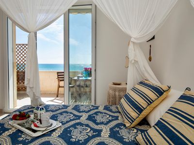 Photo for Unforgettable sunrises and spectacular sunsets in a house of new renovation on the sea