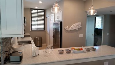 Newly remodeled kitchen featuring quartz counter tops and stainless appliances.