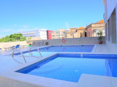 Photo for LAGOS CENTRAL, TOP FLOOR, HEATED POOL, AC/HEATING SYSTEM, FITNESS/SPA, WIFI