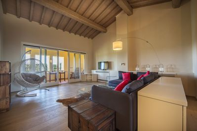 Main living room area with outside loggia beyond