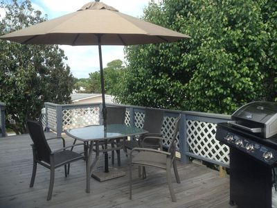Deck, umbrella table, and gas grill