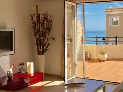 Photo for Modern apartment with WIFI, pool and large terrace with sea views
