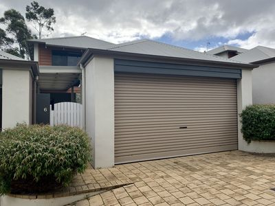 Secure double garage at front of building .