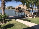 View of the Arroyo Colorado, fishing pier and palapa from the porch.