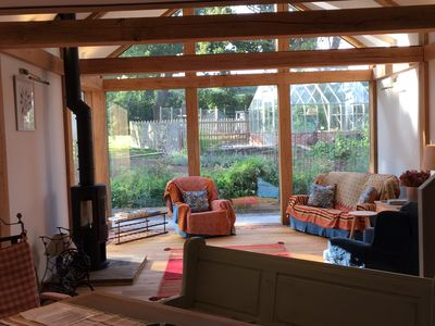 Open plan main sitting area with log burner
