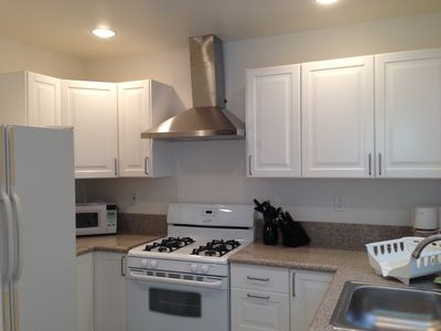 Newly remodeled kitchen with granite countertops, new stove and lots of light!