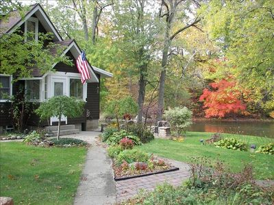 Riverside Patio with Fieldstone BBQ, beautiful landscape and Park like setting