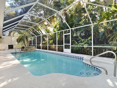 Photo for This beauty is centrally located,  with a heated pool and water fall!