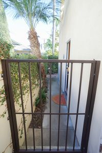 front entrance secure and gated with keybox code and intercom to unit