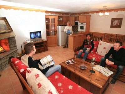 Photo for Surface area : about 160 m². Orientation : East. Living room with settee, fireplace, safe