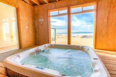 Best of both worlds!  Enjoy yourself in the enclosed hot tub room while gazing upon the sandy beach and surf of the Pacific.