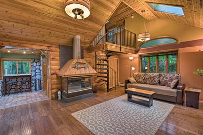 Curl up by the fire in the evening at this vacation rental!